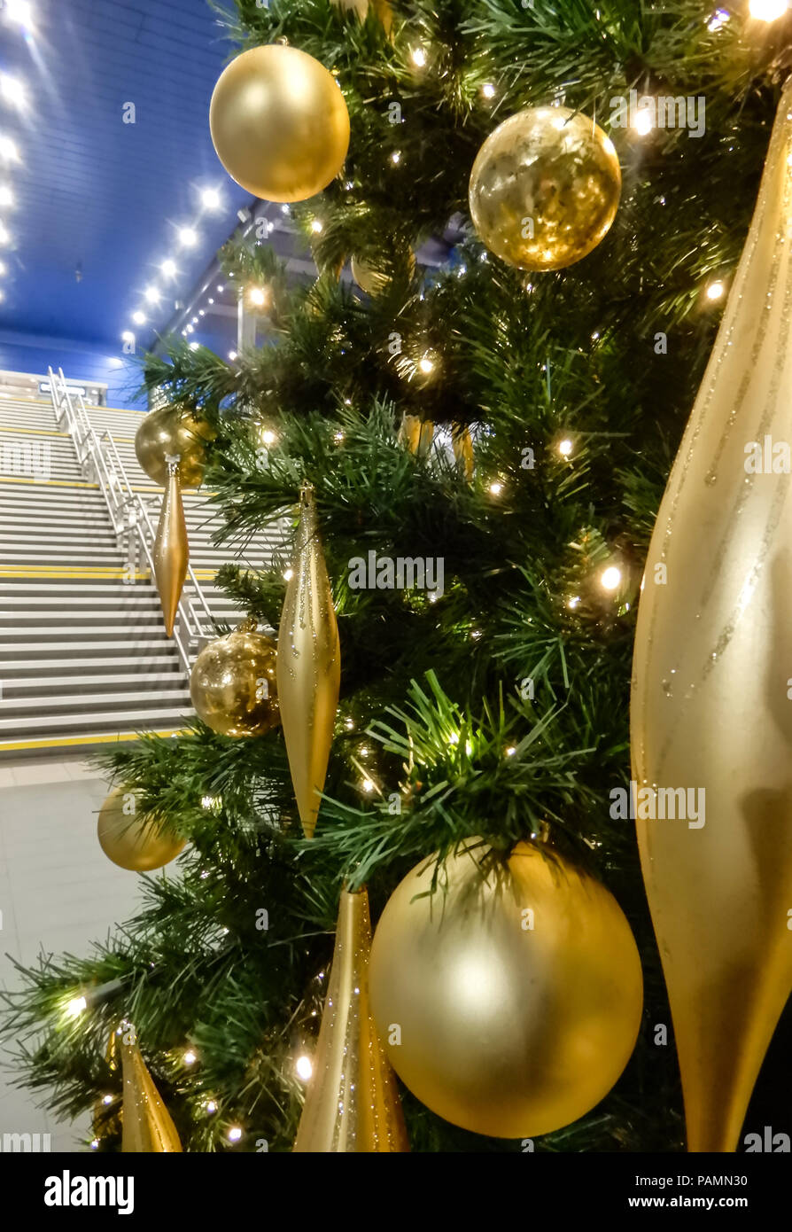 reading united kingdom january 02 2018 the christmas tree at reading train station with the steps to the over platform bridge in the background