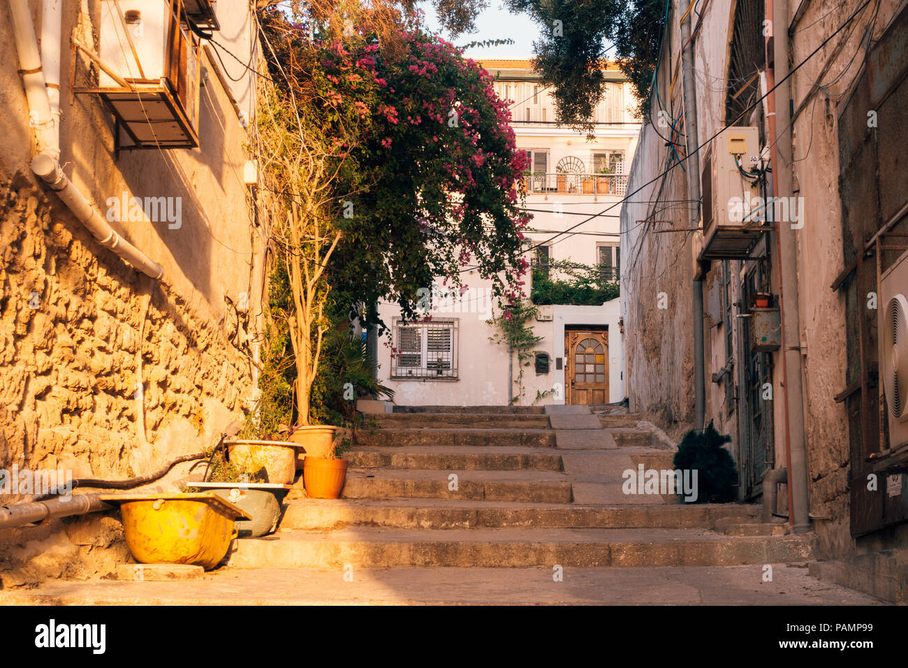 a stone alleyway with stairs at sunset in Old Jaffa, Tel Aviv-Yafo, Israel - Stock Image