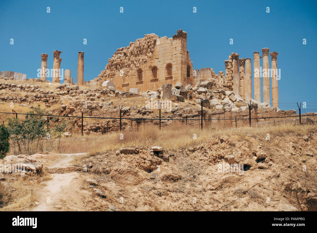 The ruined stones, concrete slabs and pillars in the ancient Mediterranean city of Jerash, Jordan Stock Photo