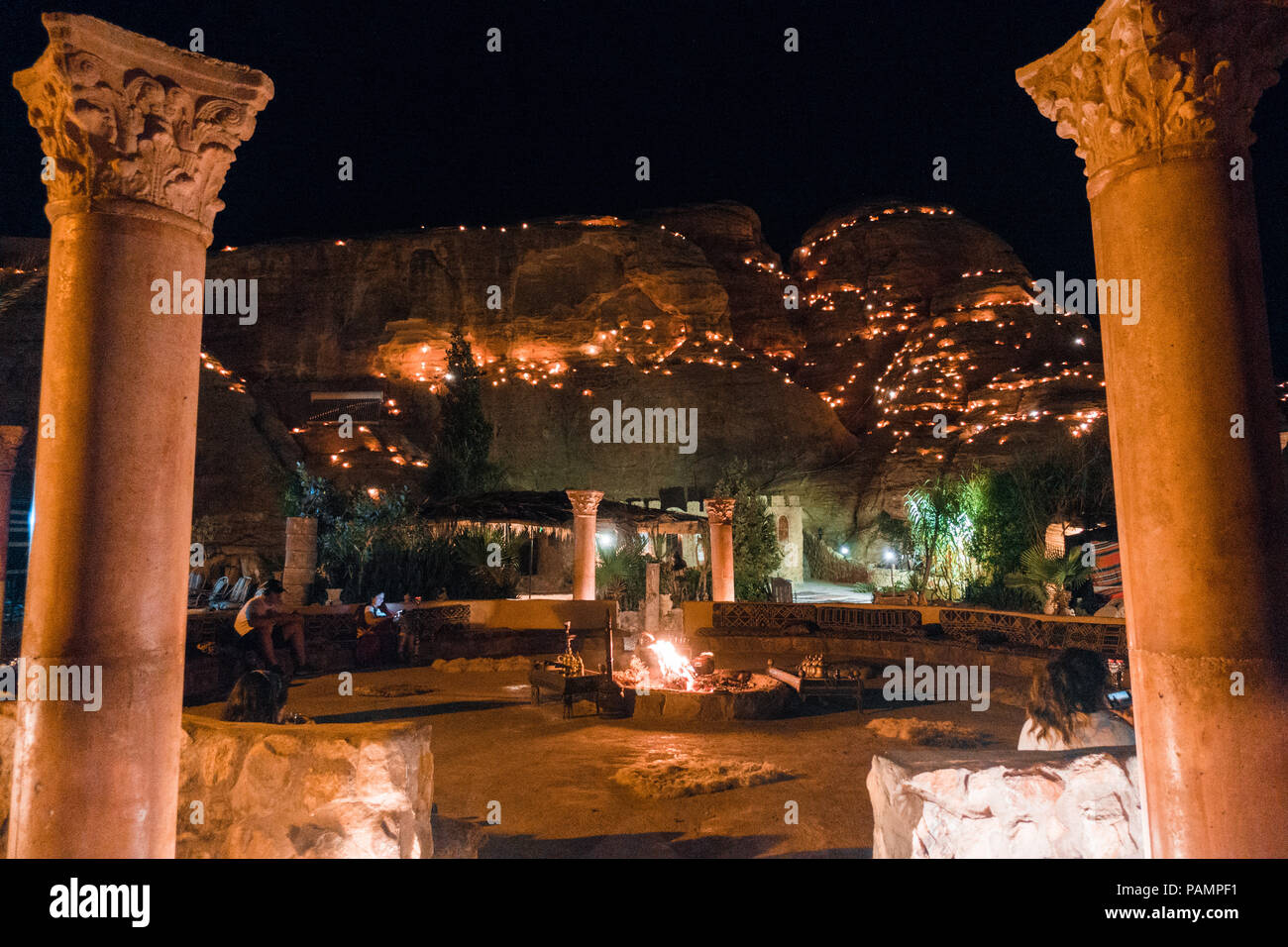 the view at night over the common area of a tourist Bedouin camp in Wadi Musa, near Petra, Jordan - Stock Image