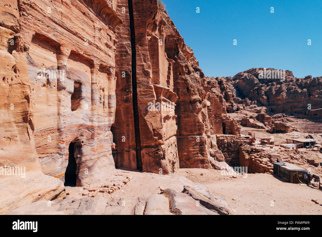 A tomb entrance carved into the rock in the Lost City of Petra, Jordan Stock Photo