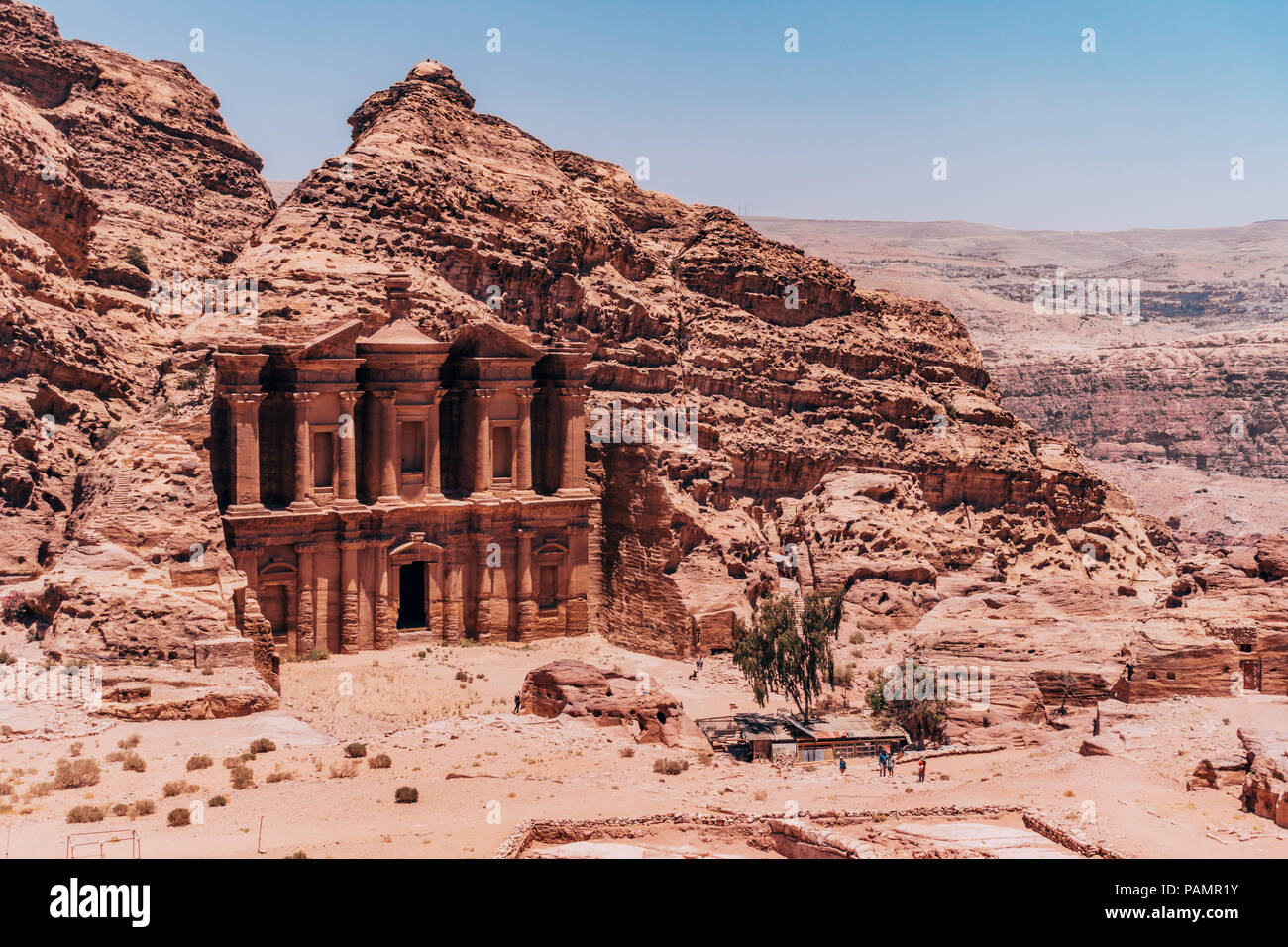looking down at the Ad-Deir Monastery carved into the side of layers of rock in the Lost City of Petra, Jordan - Stock Image