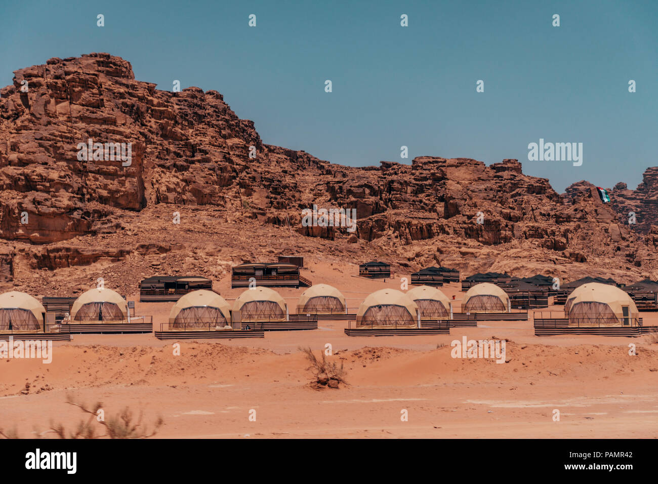 dome-like hotel rooms in the style of Ridley Scott's The Martian film clustered together at SunCity camp in Wadi Rum National Park, Jordan Stock Photo