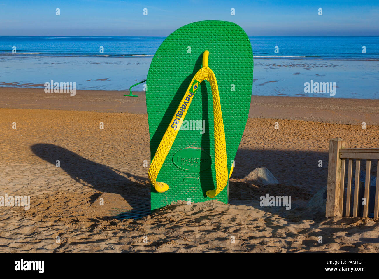 24 June 2018: Newquay, Cornwall UK - A beach shower in the shape of a big flip flop on Fistral Beach. - Stock Image
