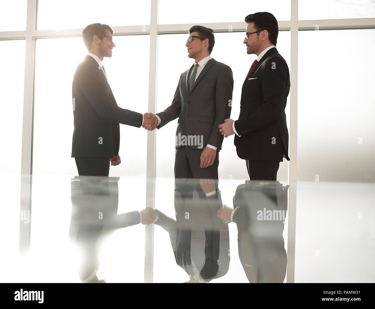 reliable handshake of business partners - Stock Image