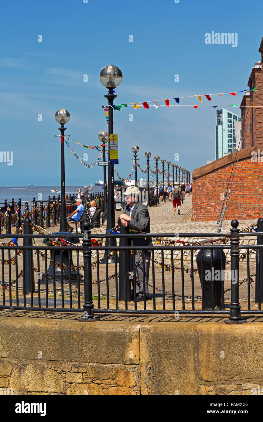 An elderly man deep in thought as he looks out over the River Mersey Liverpool UK - Stock Image