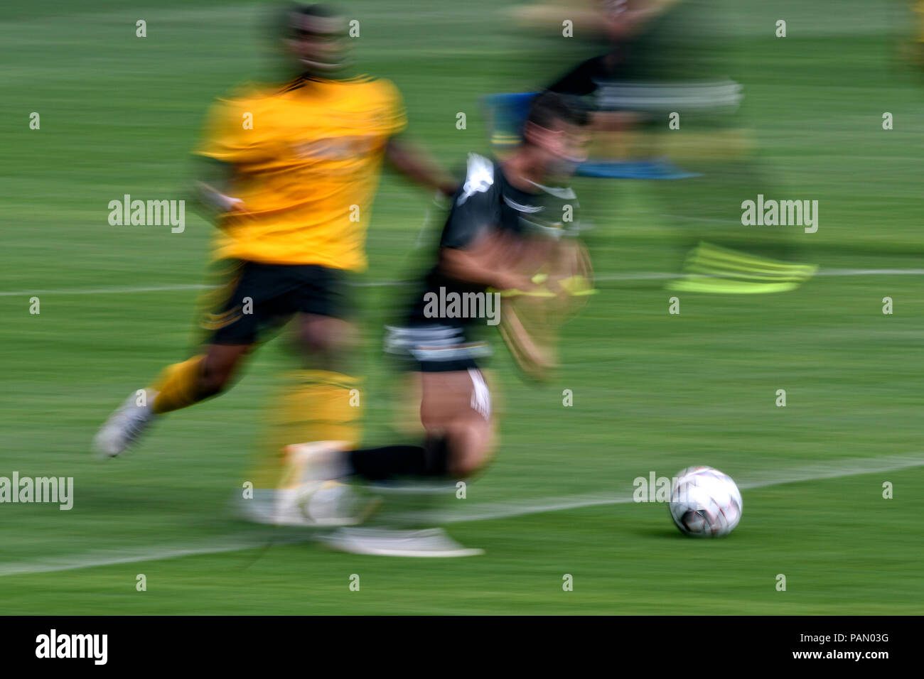 Soccer feature, legs and ball - Stock Image
