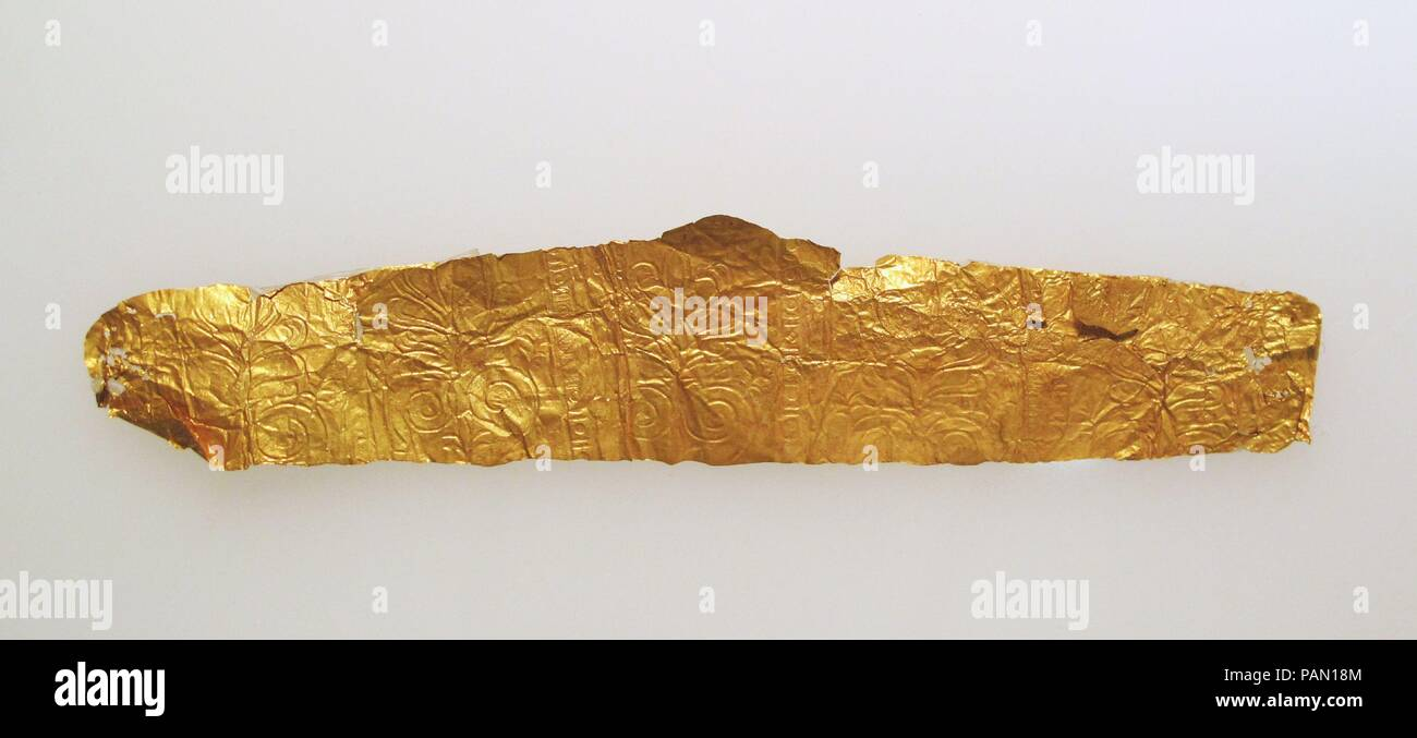 Frontlet of gold leaf. Dimensions: Other: 1 1/8 × 5 3/16 in. (2.8 × 13.2 cm). Museum: Metropolitan Museum of Art, New York, USA. Stock Photo