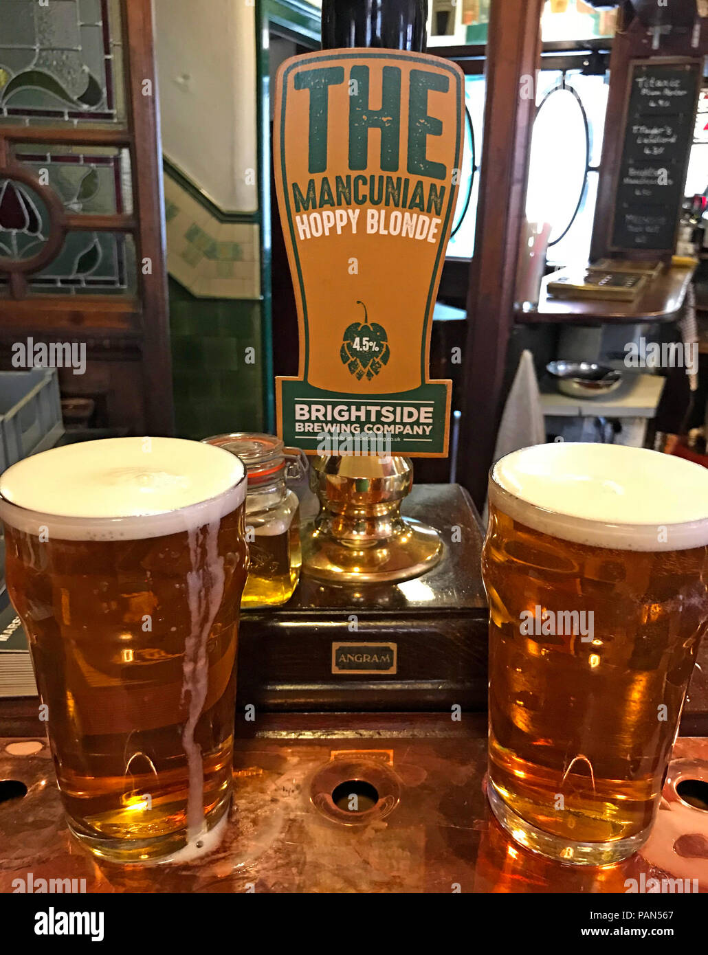 Two pints of Brightside Mancunian Hoppy Blond real ale, on a bar, Manchester,North West England, UK - Stock Image