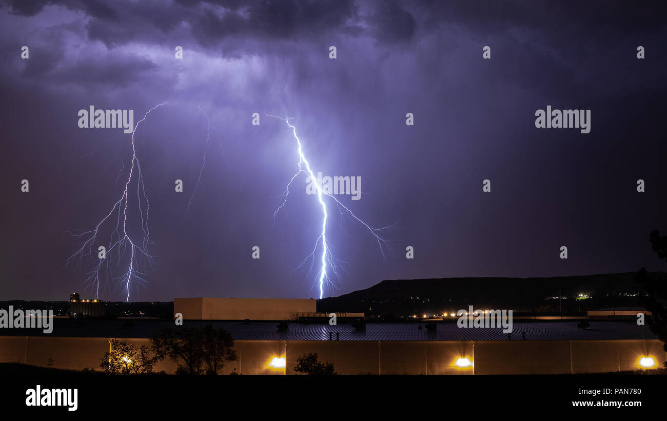 Lightning bolts streaking down from storm clouds over Lakewood, Colorado USA - Stock Image