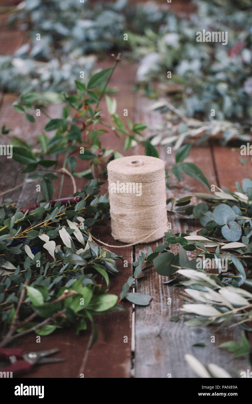 Cord on wooden table, twigs - Stock Image