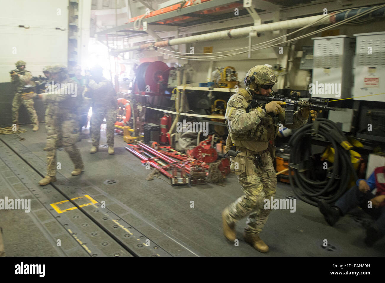 180719-G-ZV557-1295 PACIFIC OCEAN (July 19, 2018) Members of the U.S. Coast Guard Tactical Delivery Team (TDT) secure the hanger deck of the guided-missile destroyer USS William P. Lawrence (DDG 110) during training operations as part of the Rim of the Pacific (RIMPAC) exercise, July 19. The TDT is part of the U.S. Coast Guard Maritime Security Response Team-West, which is the service's only offensively oriented counter-terrorist team and play a critical role in the Department of Homeland Security's maritime defense strategy. Twenty-five nations, 46 ships and five submarines, about 200 aircraf - Stock Image