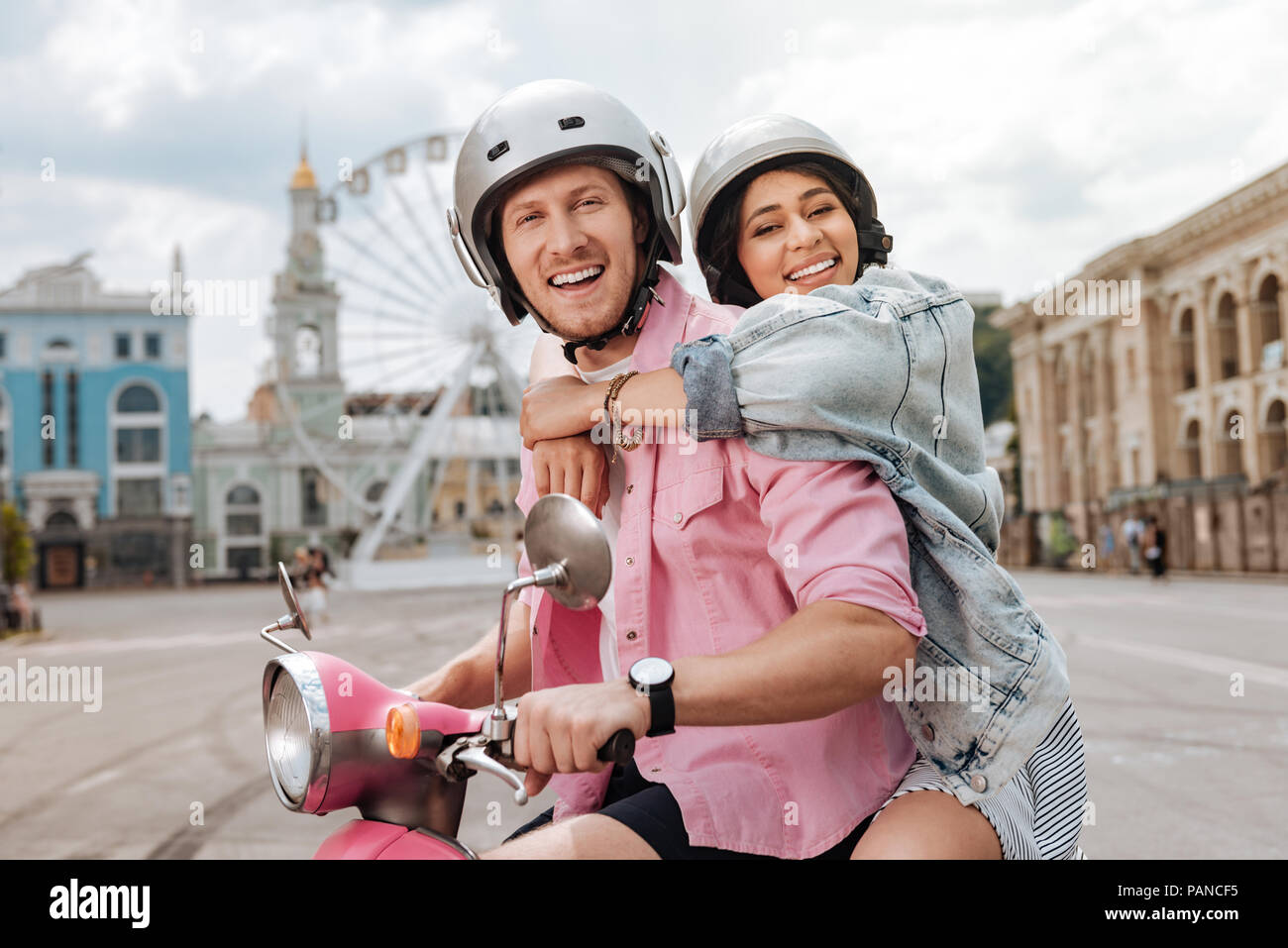 Loving jovial couple exploring city - Stock Image