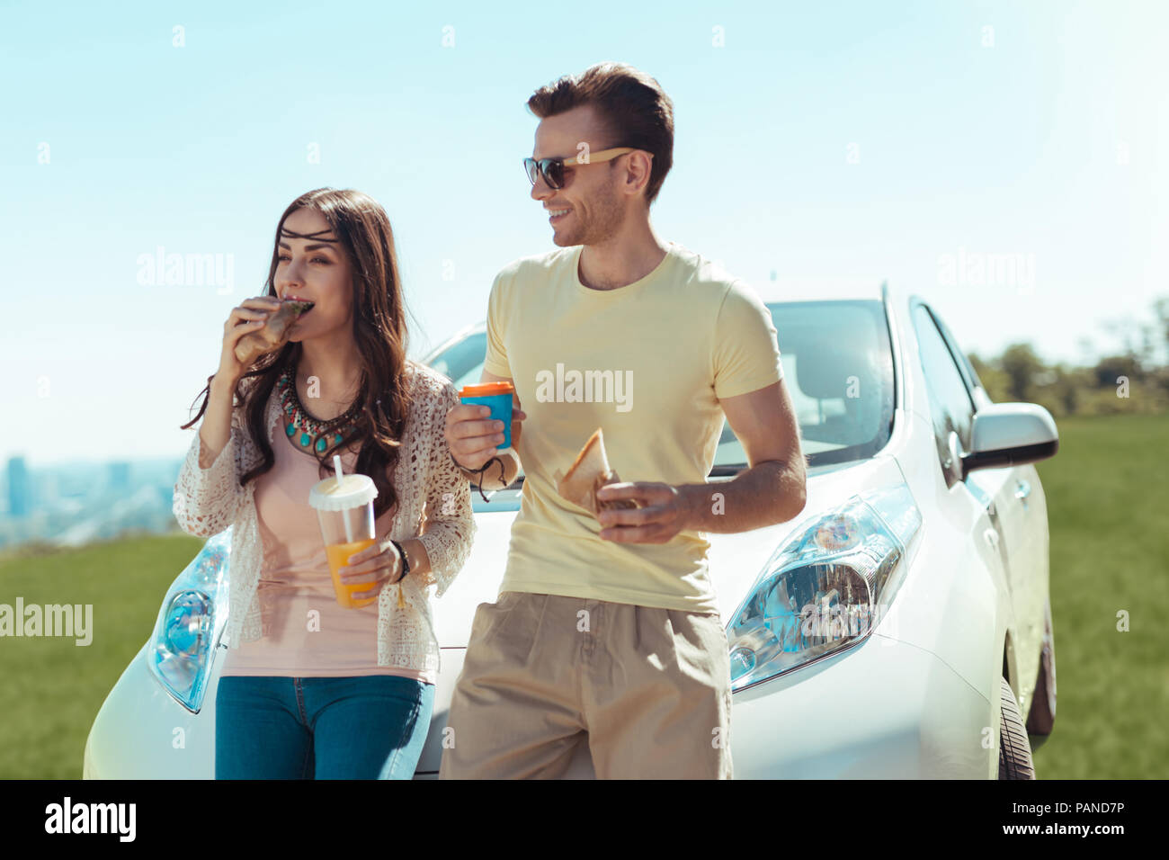 Just married couple having lunch break on the way to seaside - Stock Image