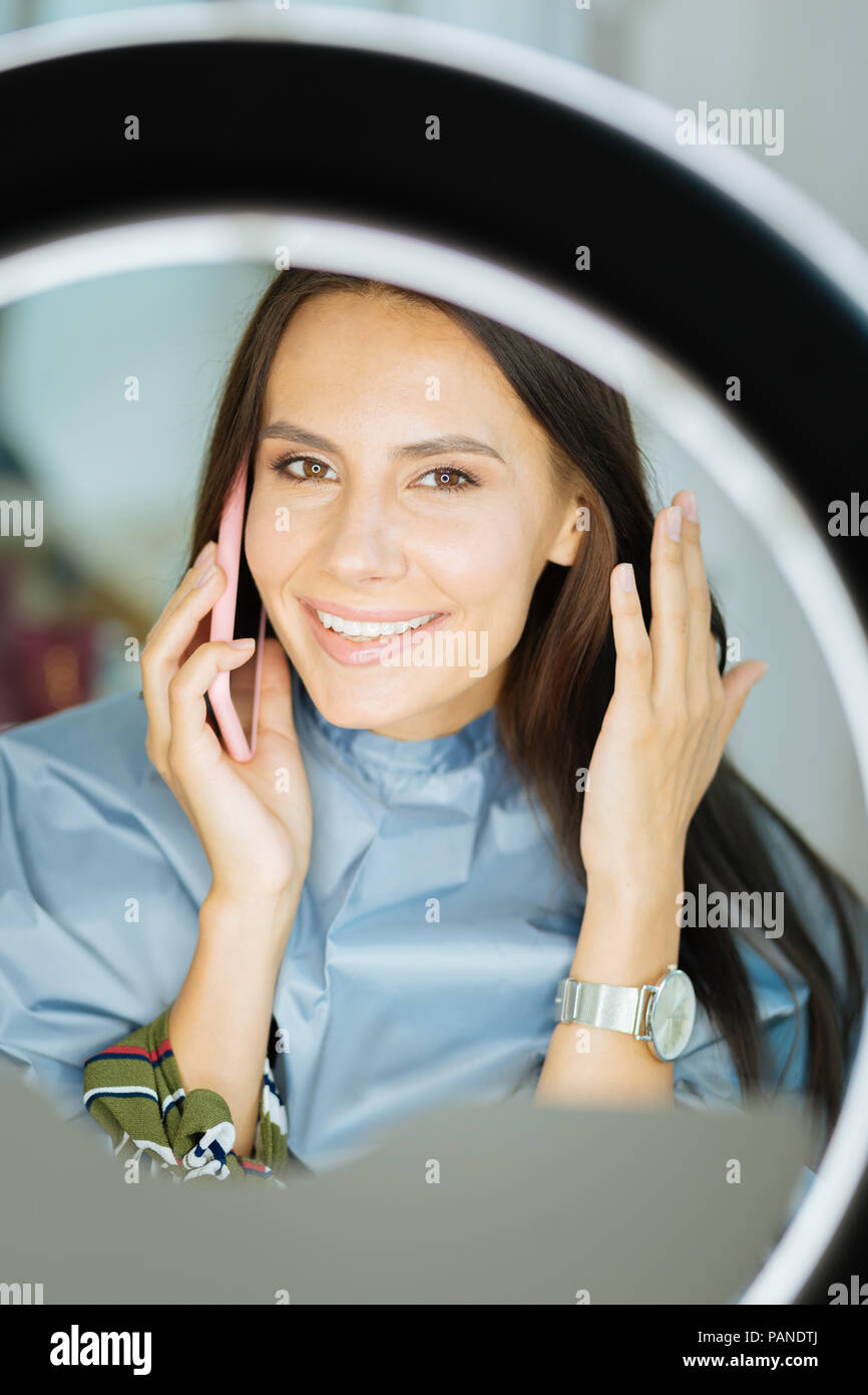 Nice happy woman making a call - Stock Image