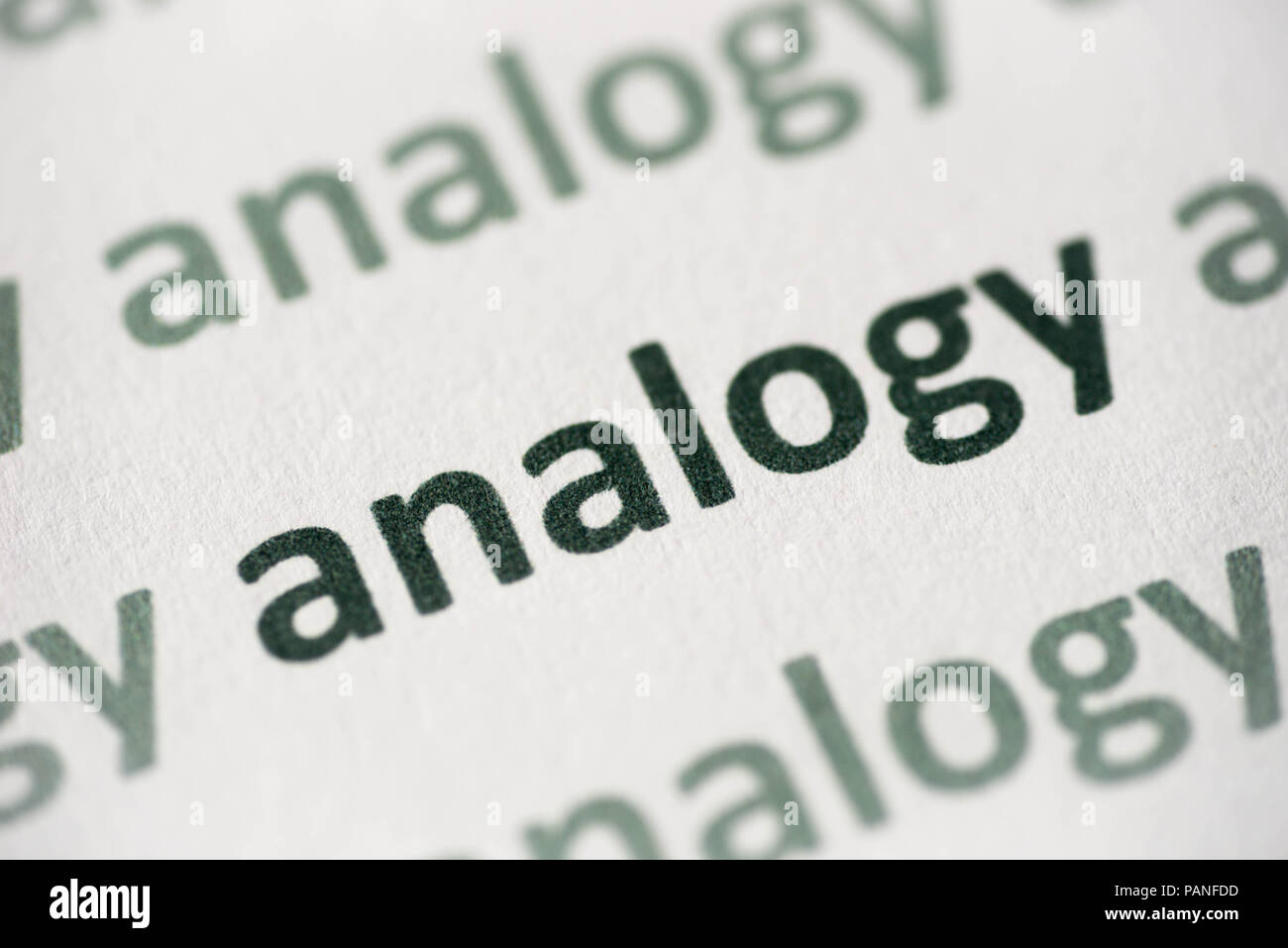 word analogy printed on white paper macro - Stock Image