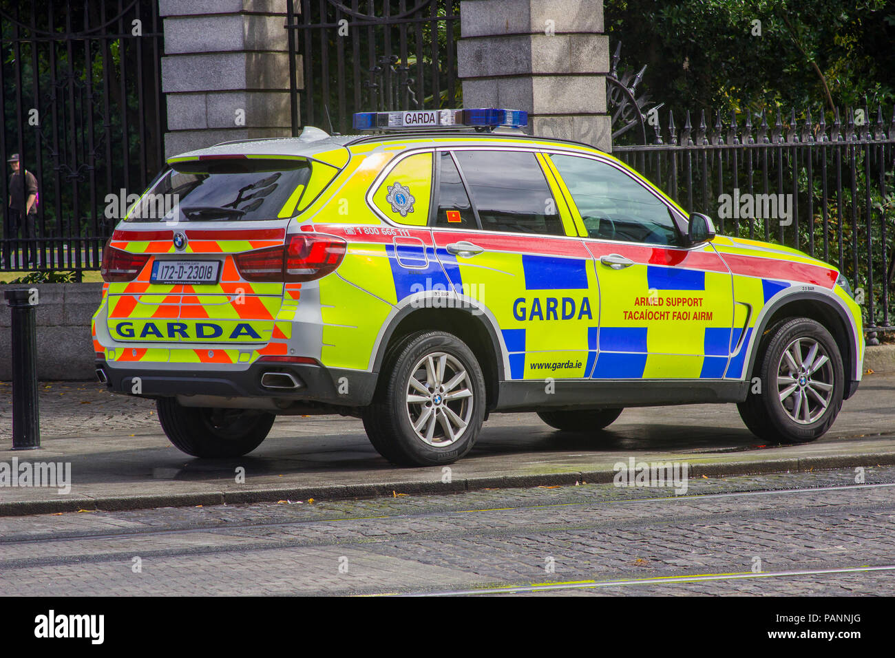 20 July 2018 An Irish police car parked on the pavement while the Garda answer an emergency in Phoenix Park Dublin Ireland Stock Photo