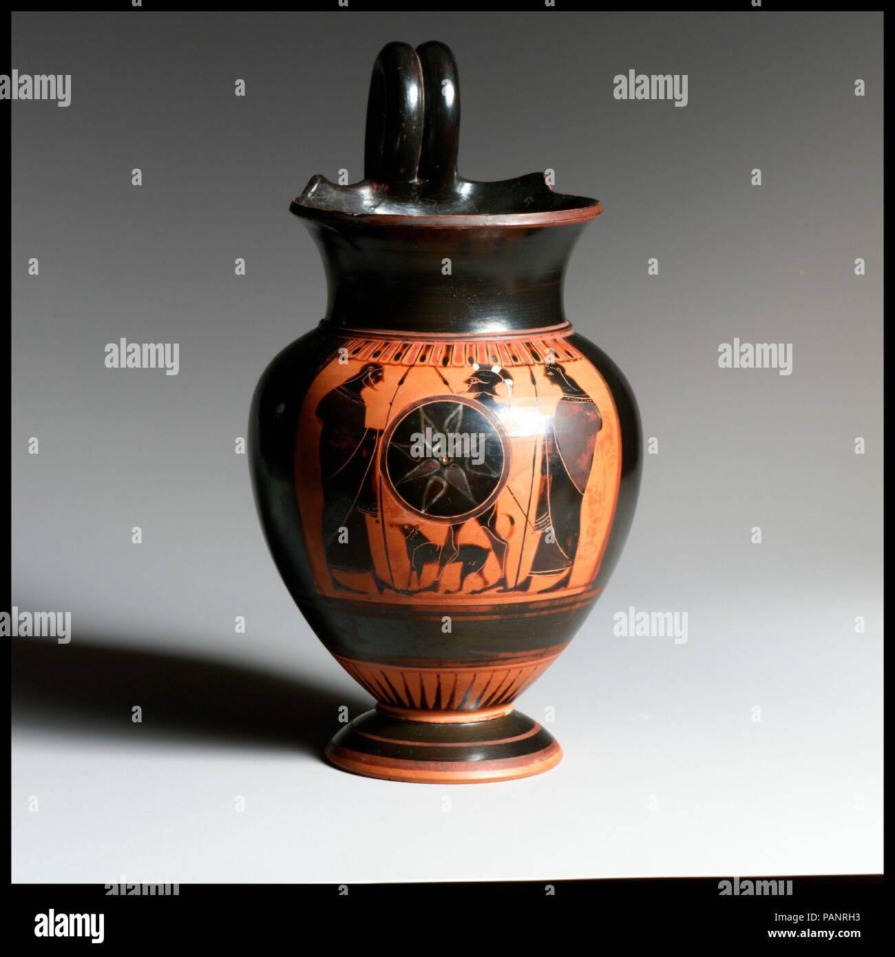 Terracotta oinochoe (jug). Culture: Greek, Attic. Dimensions: 7 1/2in. (19.1cm). Date: ca. 550 B.C..  Warrior departing. Museum: Metropolitan Museum of Art, New York, USA. Stock Photo