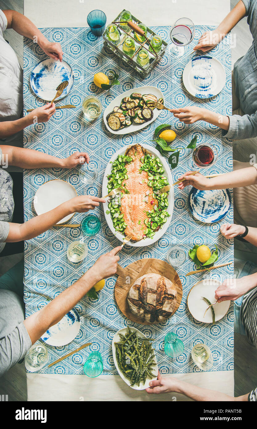 Family or friends having seafood summer dinner - Stock Image