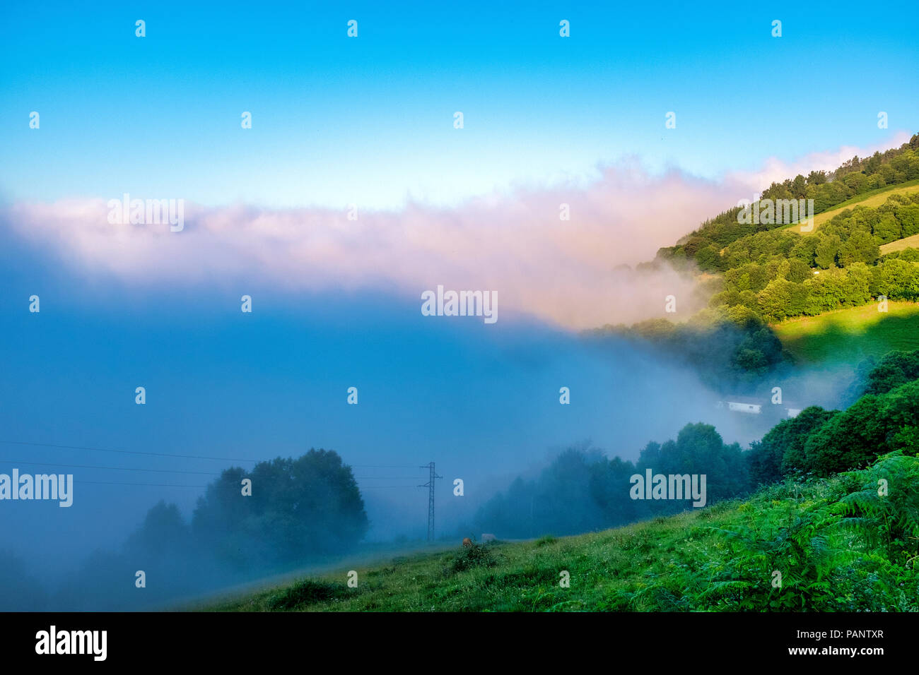 Sunrise over the mist over the hills of Tineo, Asturias, Spain - Stock Image
