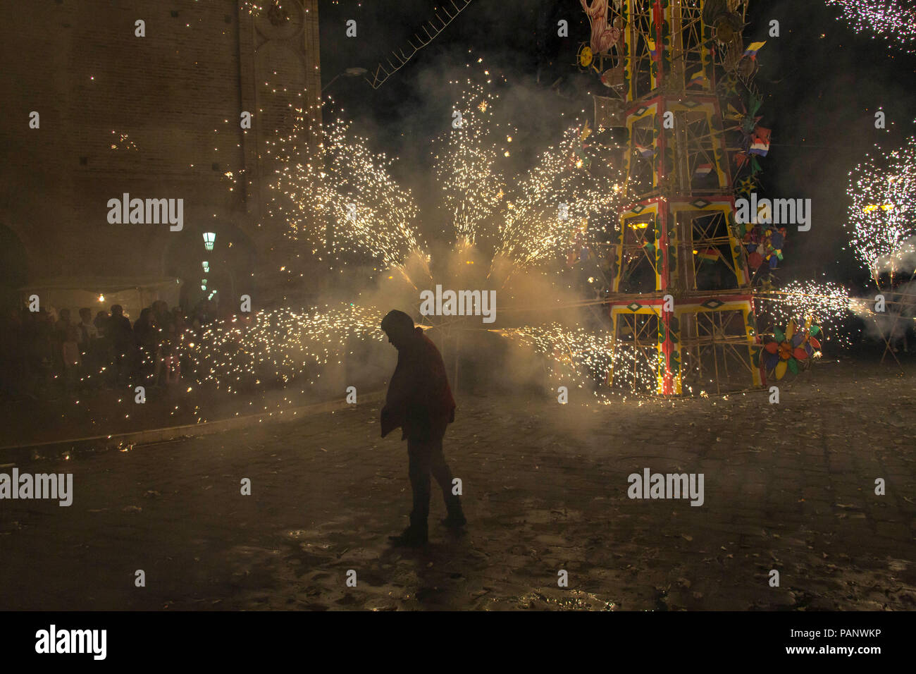 Silhouetted figure in the celebratory fireworks at the Corpus Christi Festival in Cuenca Ecuador - Stock Image