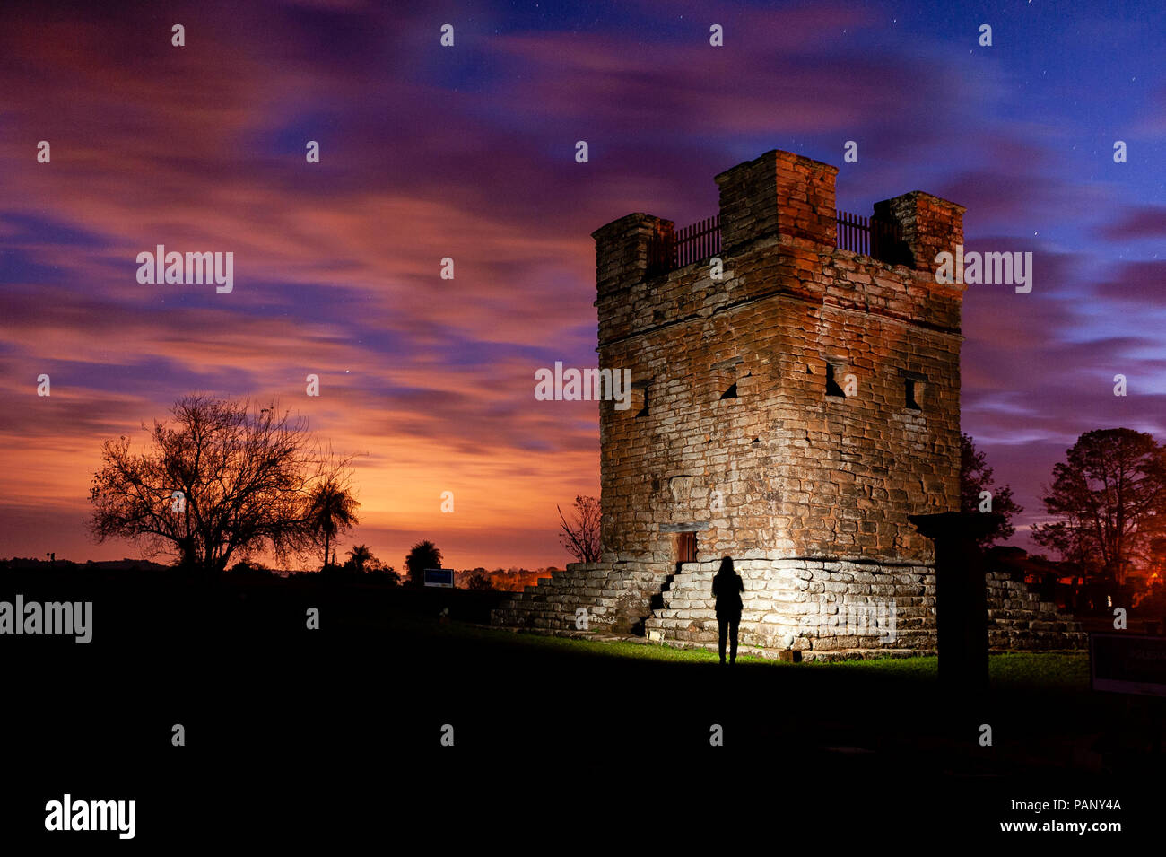 Illuminating belfry in Jesuit ruin during sunset - Stock Image