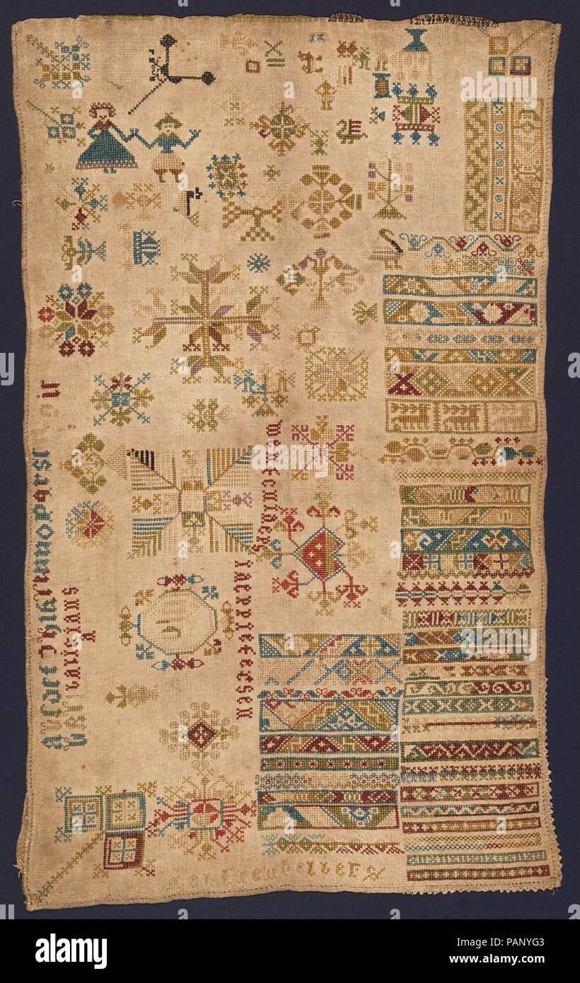 Sampler with geometric patterns, lettering, and various
