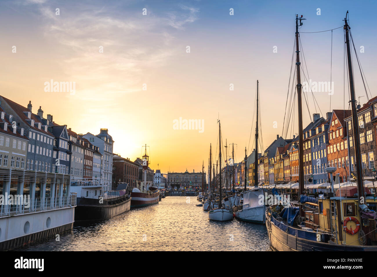 Copenhagen sunset city skyline at Nyhavn harbour, Copenhagen Denmark - Stock Image
