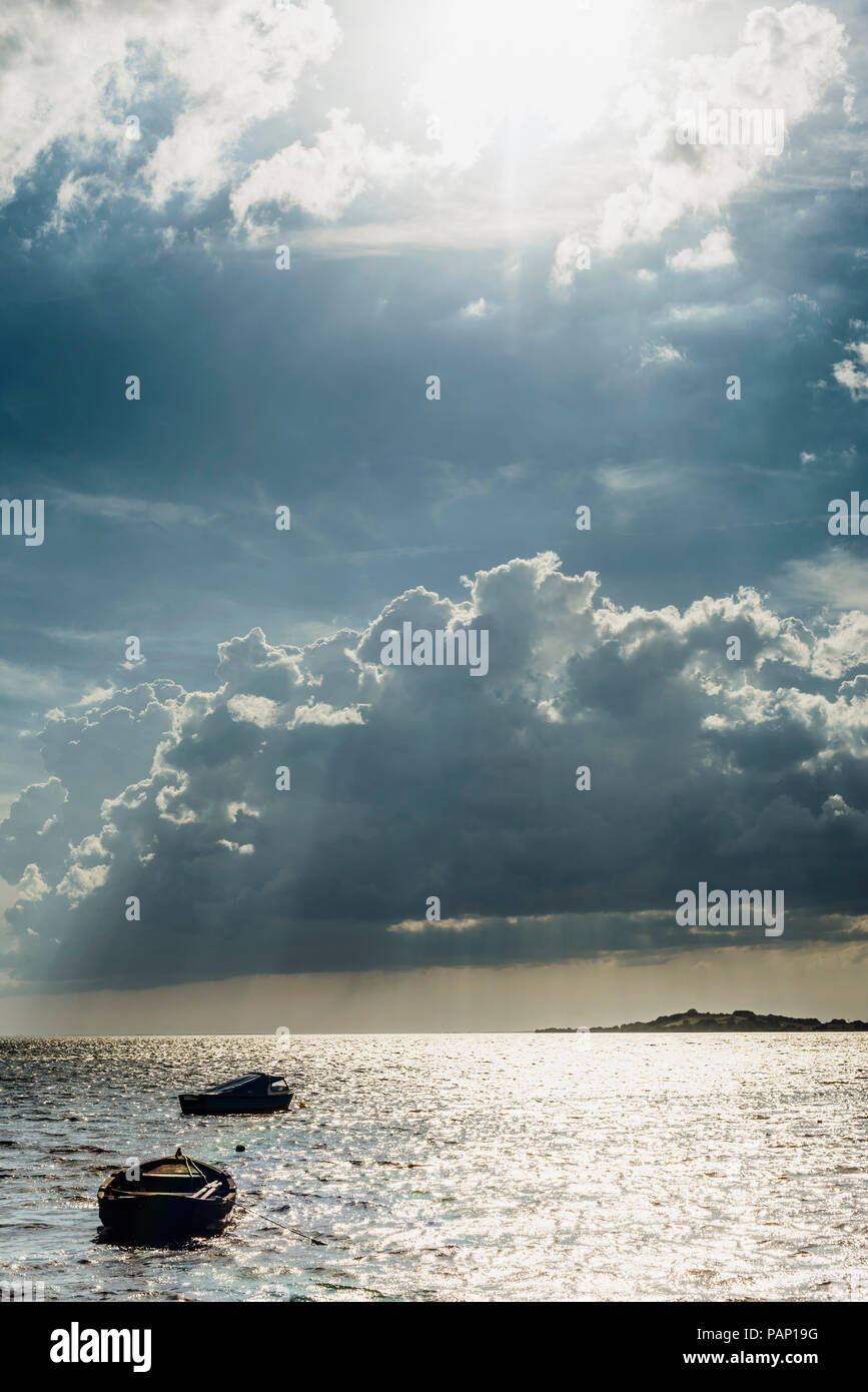 Germany, Ruegen, boats floating on the sea under cloudy sky - Stock Image