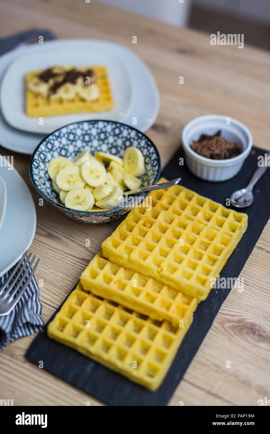 Waffles, banana slices and chocolate shaving - Stock Image