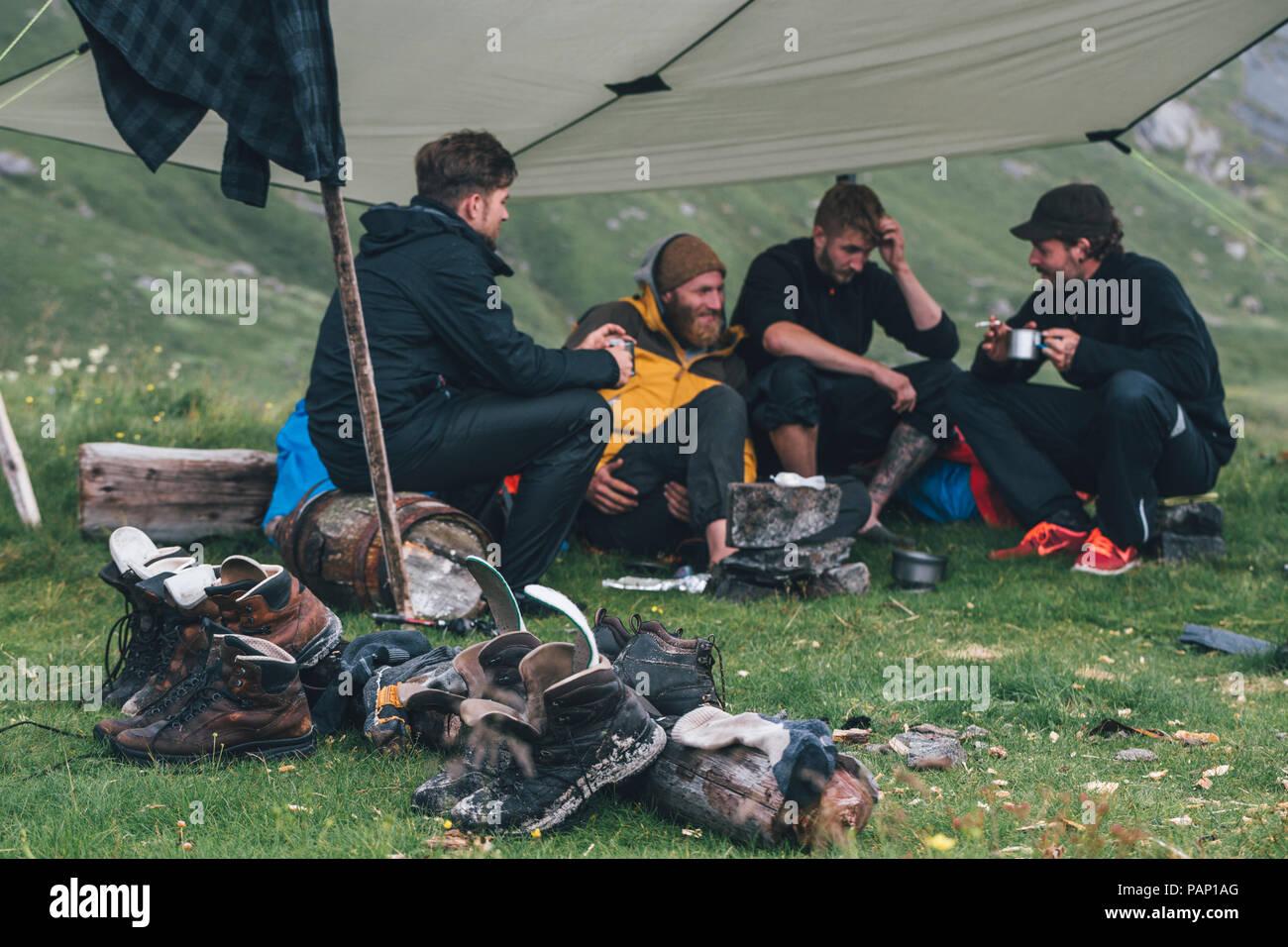 Norway, Lofoten, Moskenesoy, Young men camping at Horseid Beach - Stock Image