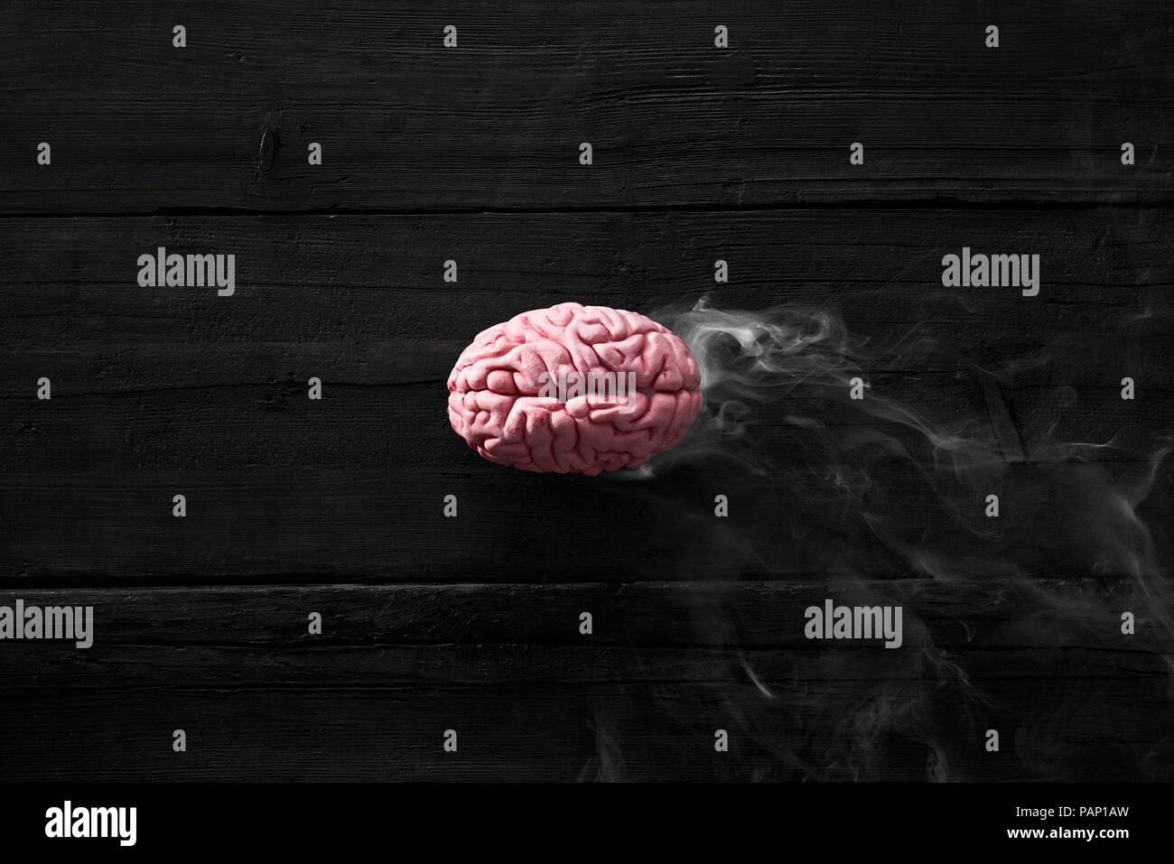 Smoking brain, burnout - Stock Image
