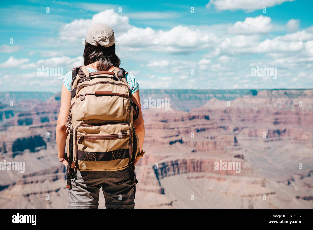 USA, Arizona, Grand Canyon National Park, Young woman with backpack exploring and enjoying the landscape - Stock Image