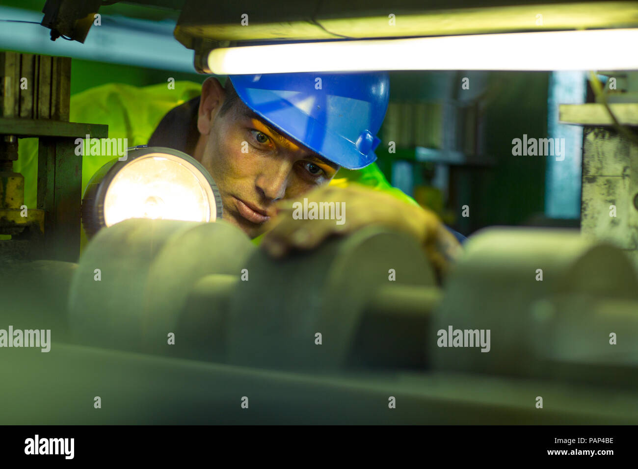 Engineer in industrial plant inspecting machines Stock Photo