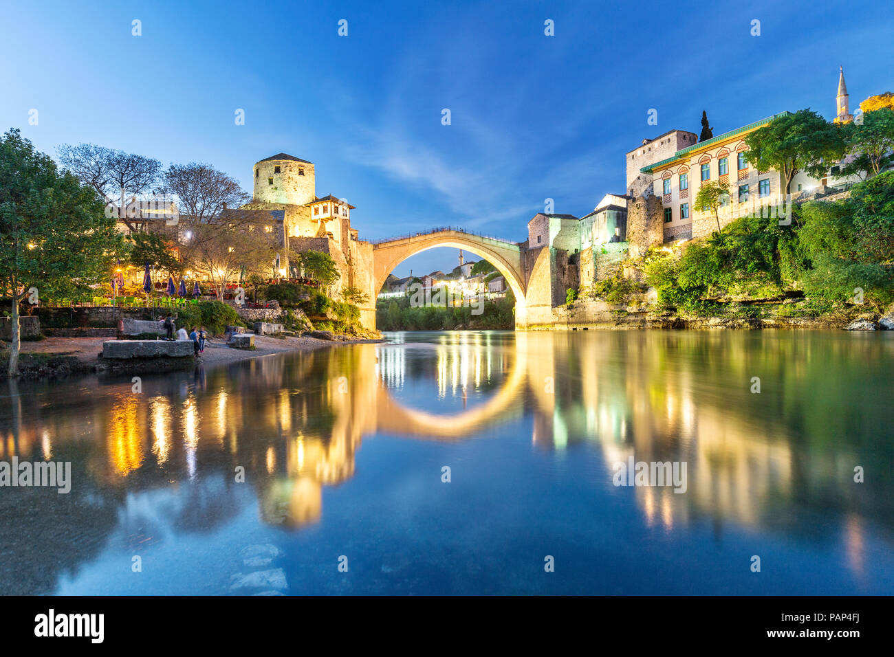 Bosnia and Herzegovina, Mostar, Old town, Old bridge and Neretva river at blue hour - Stock Image