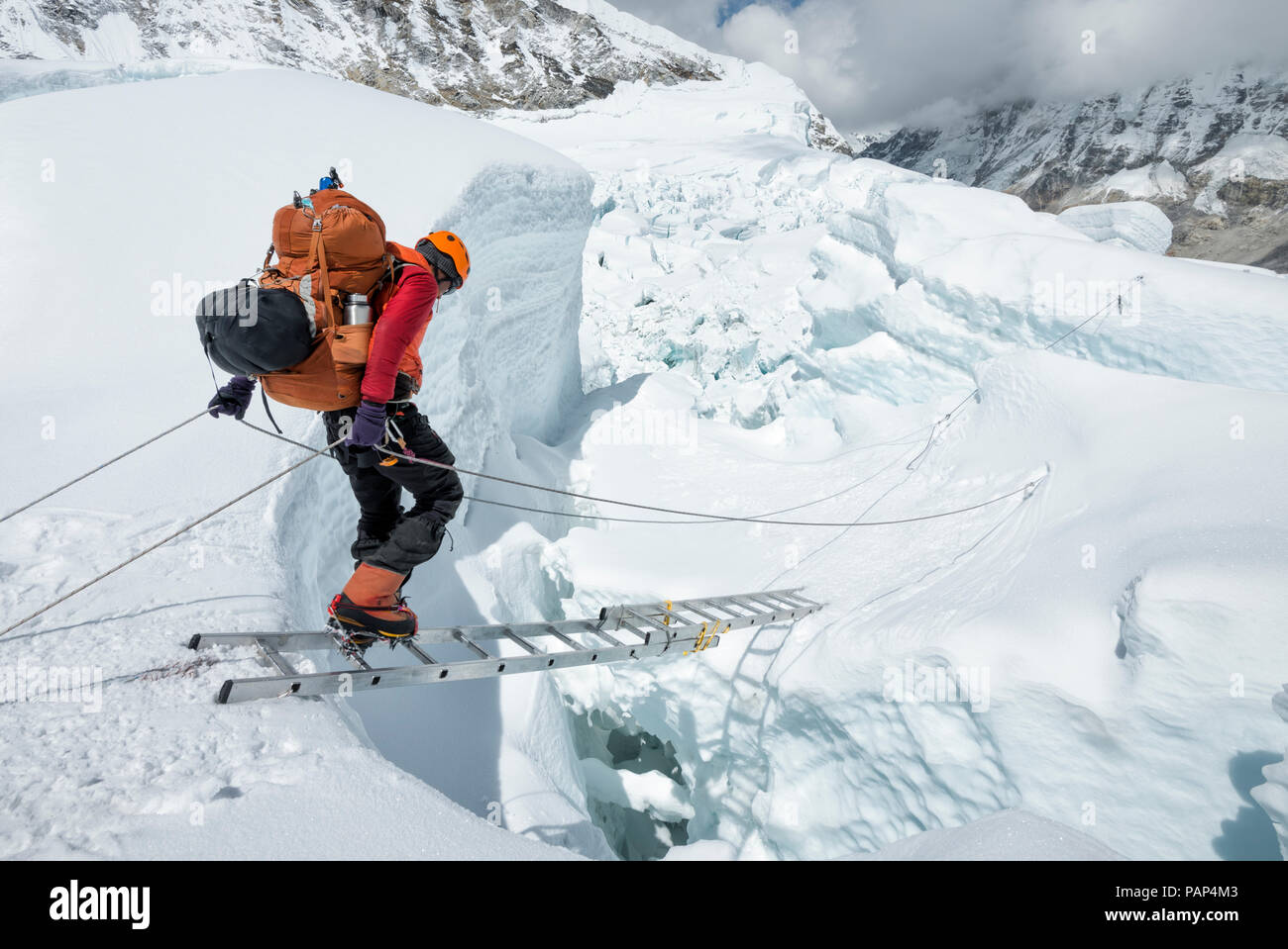 Nepal, Solo Khumbu, Everest, Sagamartha National Park, Mountaineer crossing icefall at Western Cwm - Stock Image