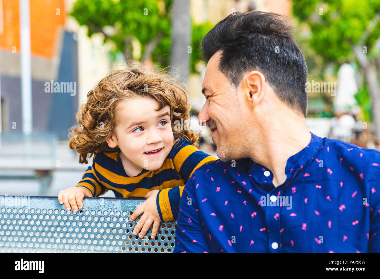 Father and son playing and looking at each other - Stock Image