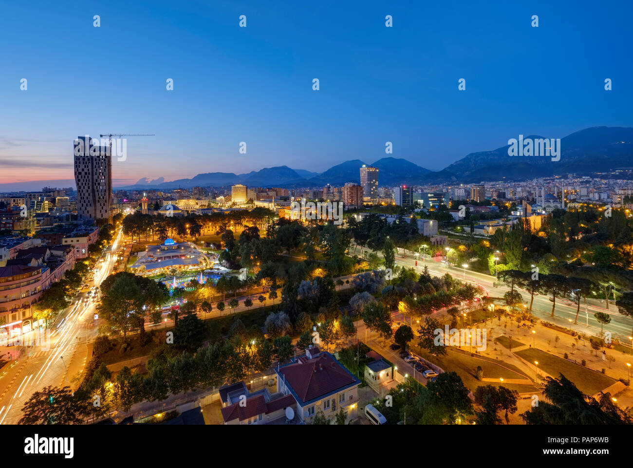 Albania, Tirana, Rinia Park and City Center in the evening - Stock Image