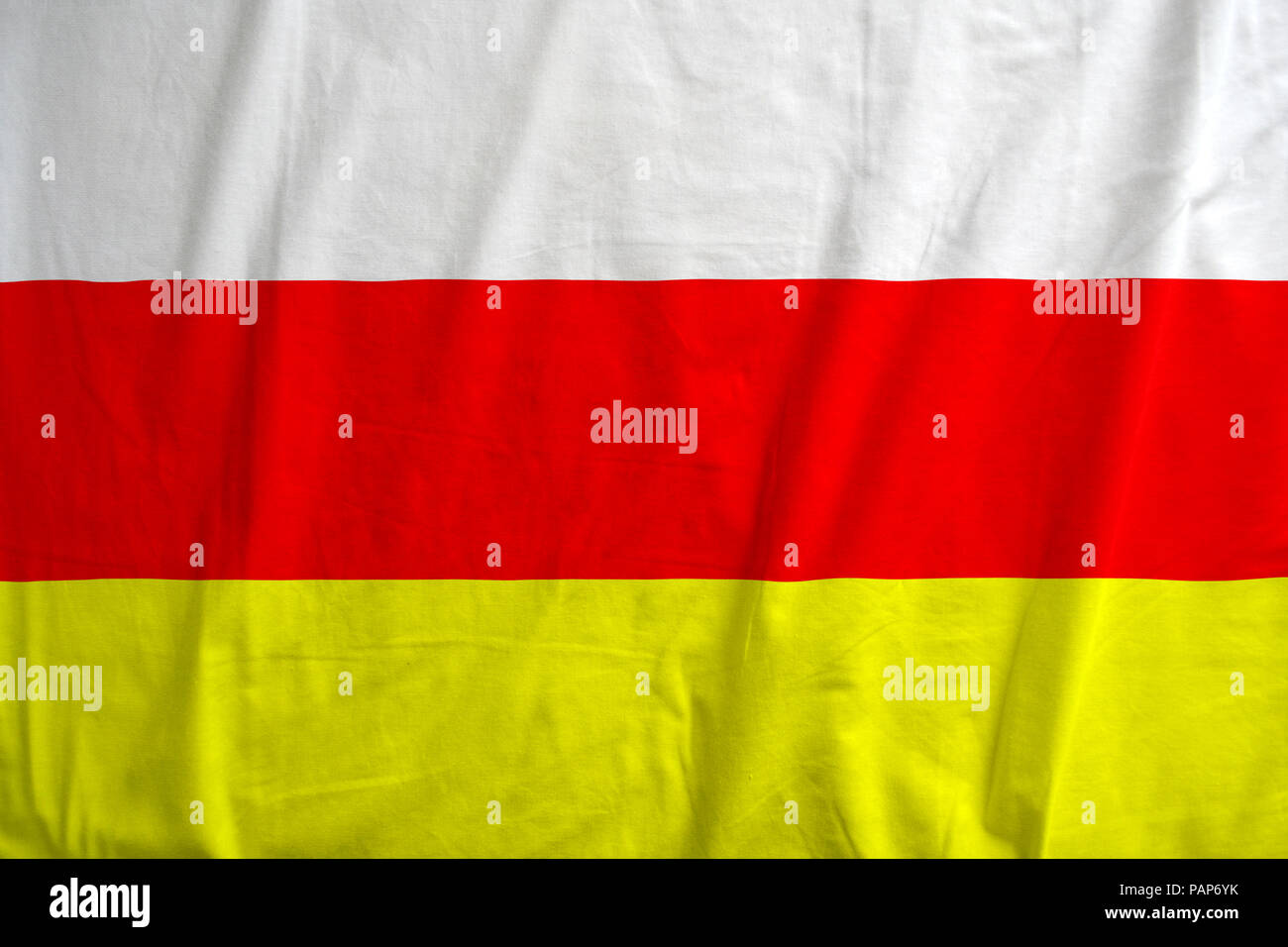 Fabric texture of the flag of South Ossetia. - Stock Image