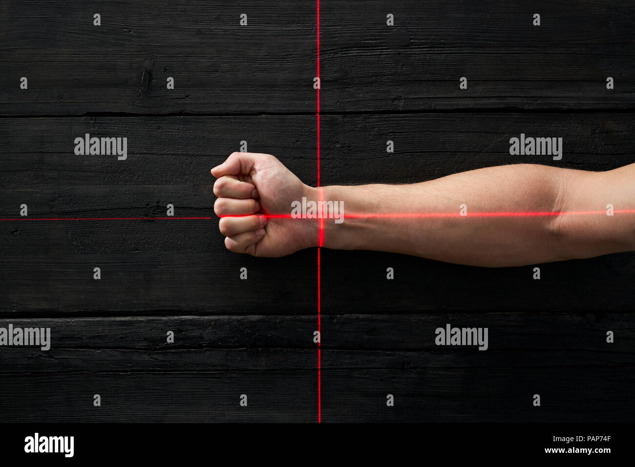 Human hand getting scanned by red light rays - Stock Image