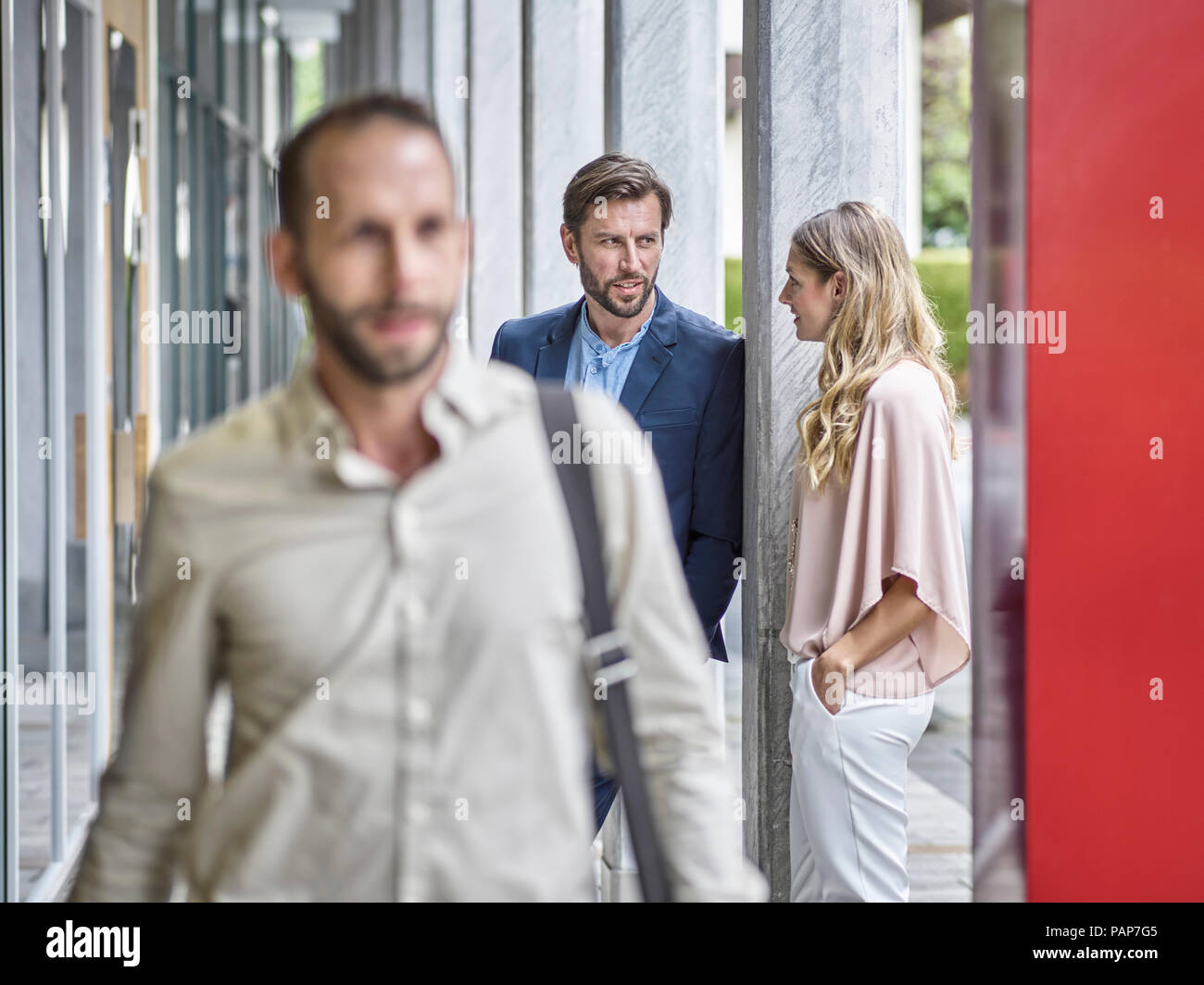 Business people talking outside office building - Stock Image