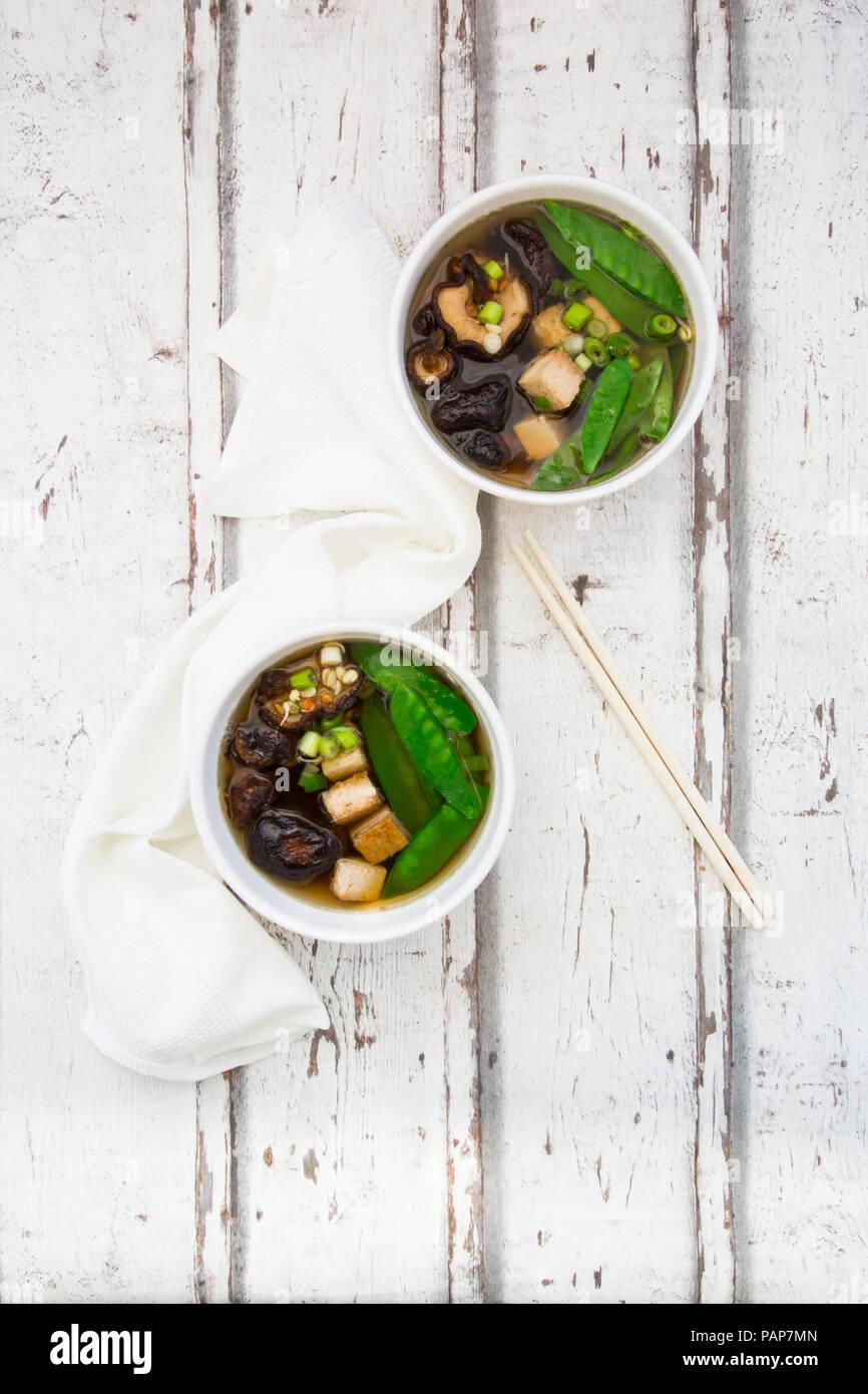Japanese miso soup, sugar peas, shitake, tofu and mung sprouts - Stock Image