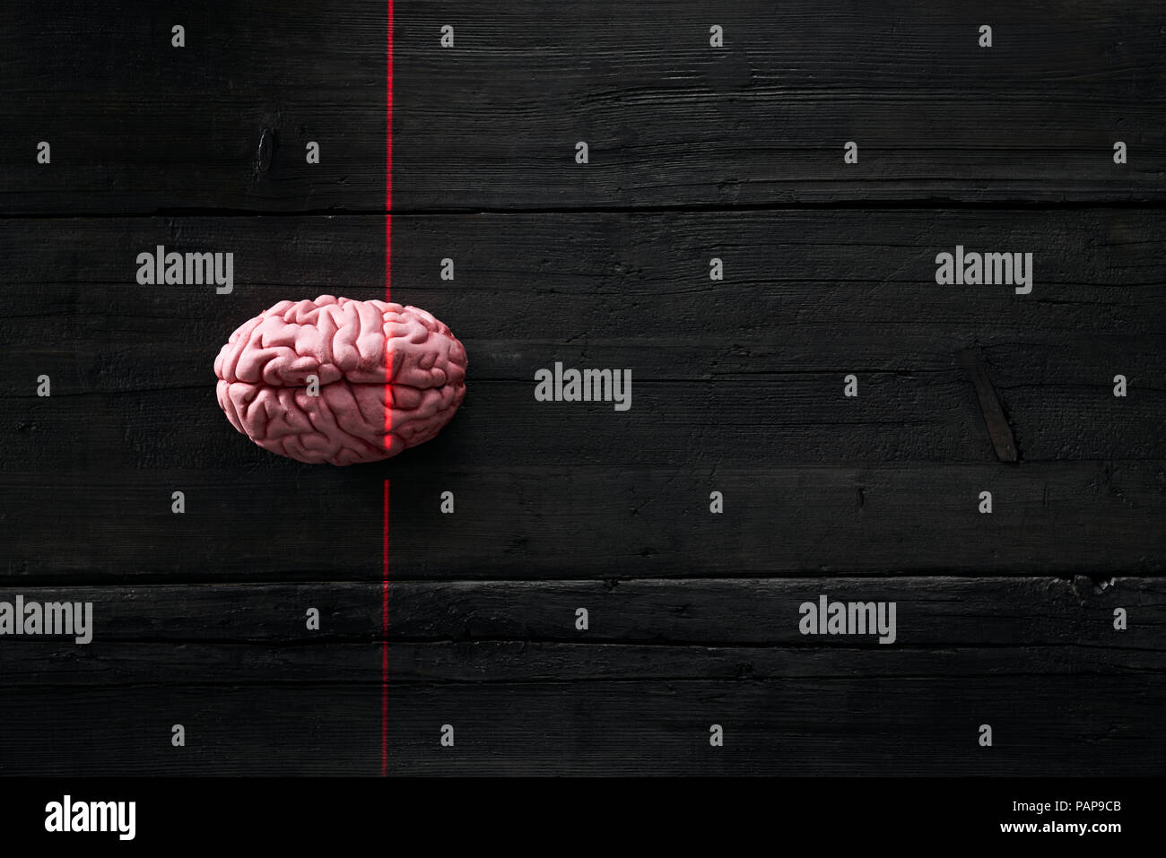 Artificial intelligence, brain getting measured by light ray - Stock Image