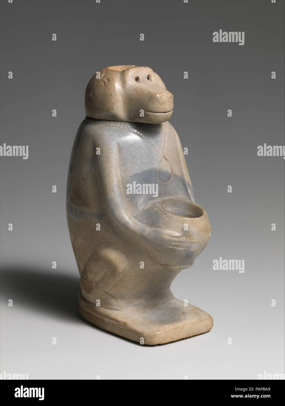 Ointment jar in the shape of a baboon. Dimensions: H. 13.3 cm (5 1/4 in.); W. 5.9 cm (2 5/16 in.); D. 8.2 cm (3 1/4 in.). Dynasty: Dynasty 13-17. Date: ca. 1800-1550 B.C.. Museum: Metropolitan Museum of Art, New York, USA. - Stock Image