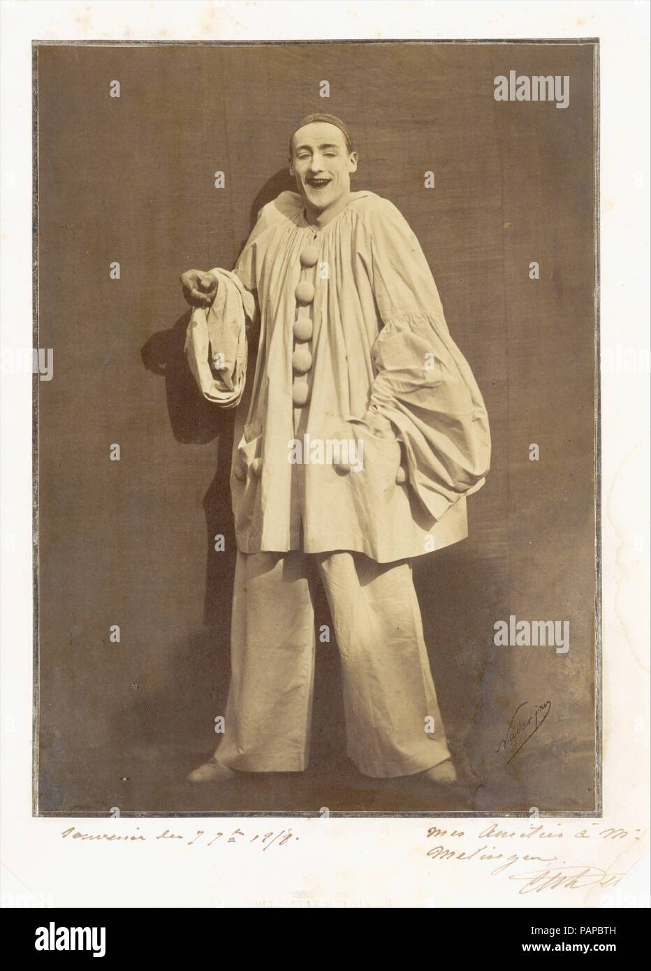 Pierrot Laughing. Artist: Adrien Tournachon (French, 1825-1903); Nadar (French, Paris 1820-1910 Paris). Dimensions: 27.3 x 19.8 cm (10 3/4 x 7 13/16 in.). Person in Photograph: Jean-Charles Deburau (French, 1829-1873). Date: 1855.  We owe the contemporary image of Pierrot to the famous mime Jean-Gaspard Baptiste Duburau, who replaced the ruff and wide white hat of the commedia dell'arte character with the long blank face and black skull cap that we recognize today.  Charles Duburau, his son and also a mime, was asked by Nadar and his brother Adrien to pose for a series of 'têtes d'expression'  - Stock Image