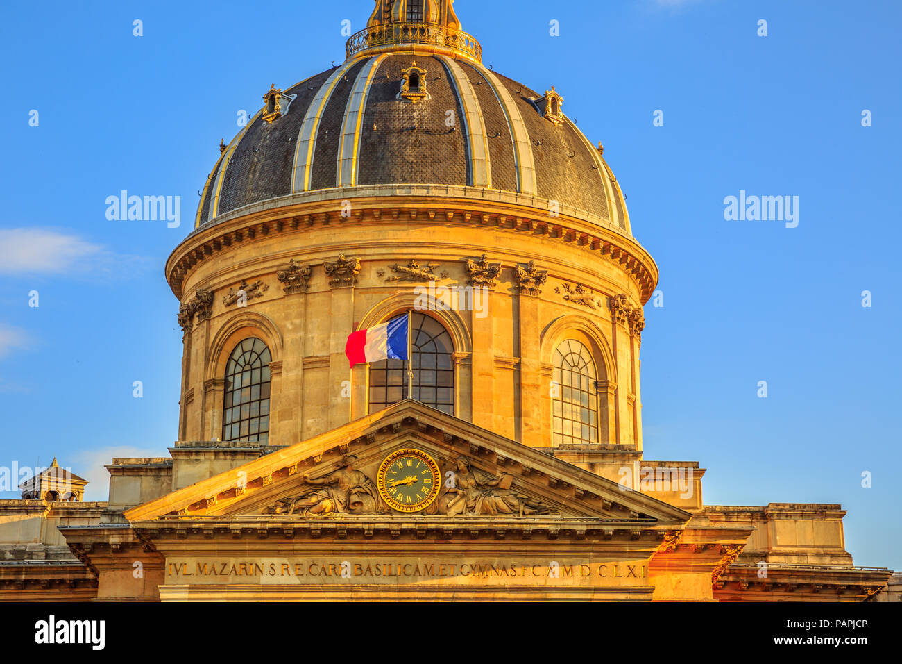 Details of central dome with French Flag of Institut de France building, a French learned society group of five academies in Paris, France, Europe. Sunny day in the blue sky. - Stock Image