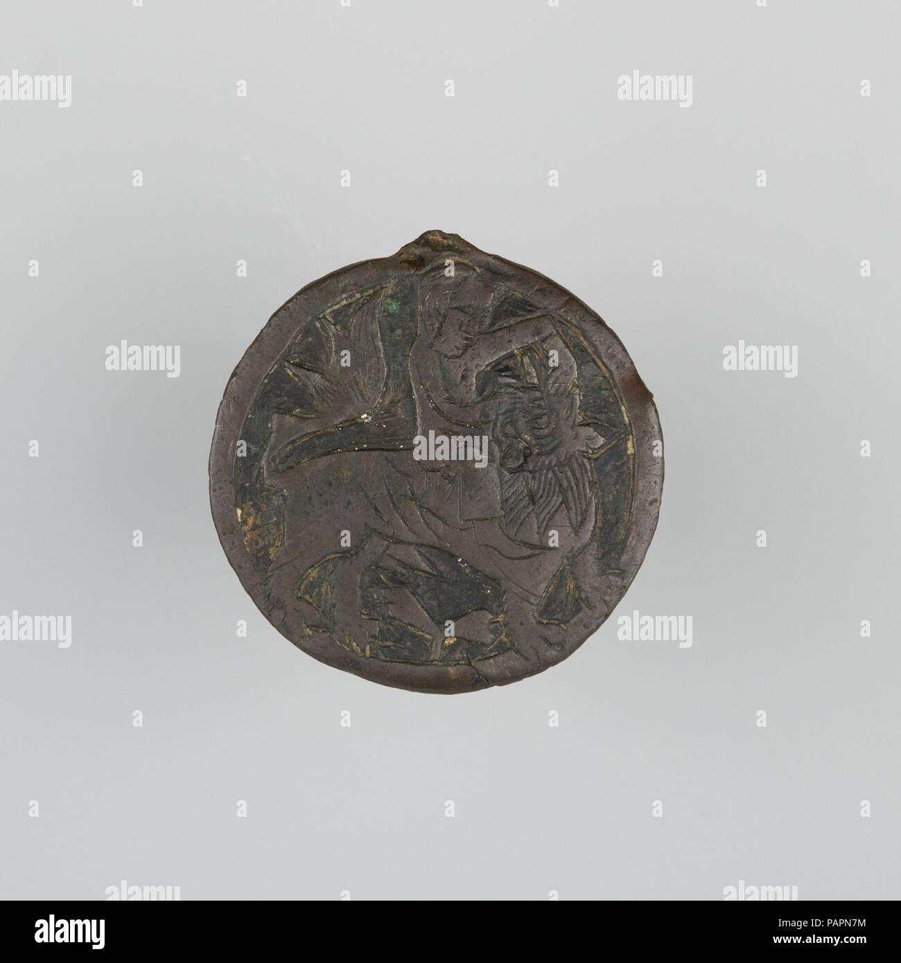 Badge. Culture: Spanish. Dimensions: Diam. 2 3/16 in. (5.5 cm); Wt. 1 oz. (28.3 g). Date: 14th century. Museum: Metropolitan Museum of Art, New York, USA. Stock Photo