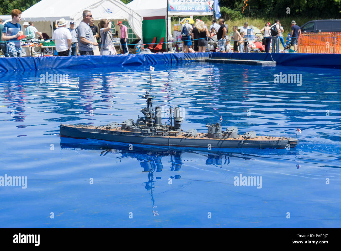 Model of Iron Duke WW1 battleship on pool at Wings and Wheels - Stock Image