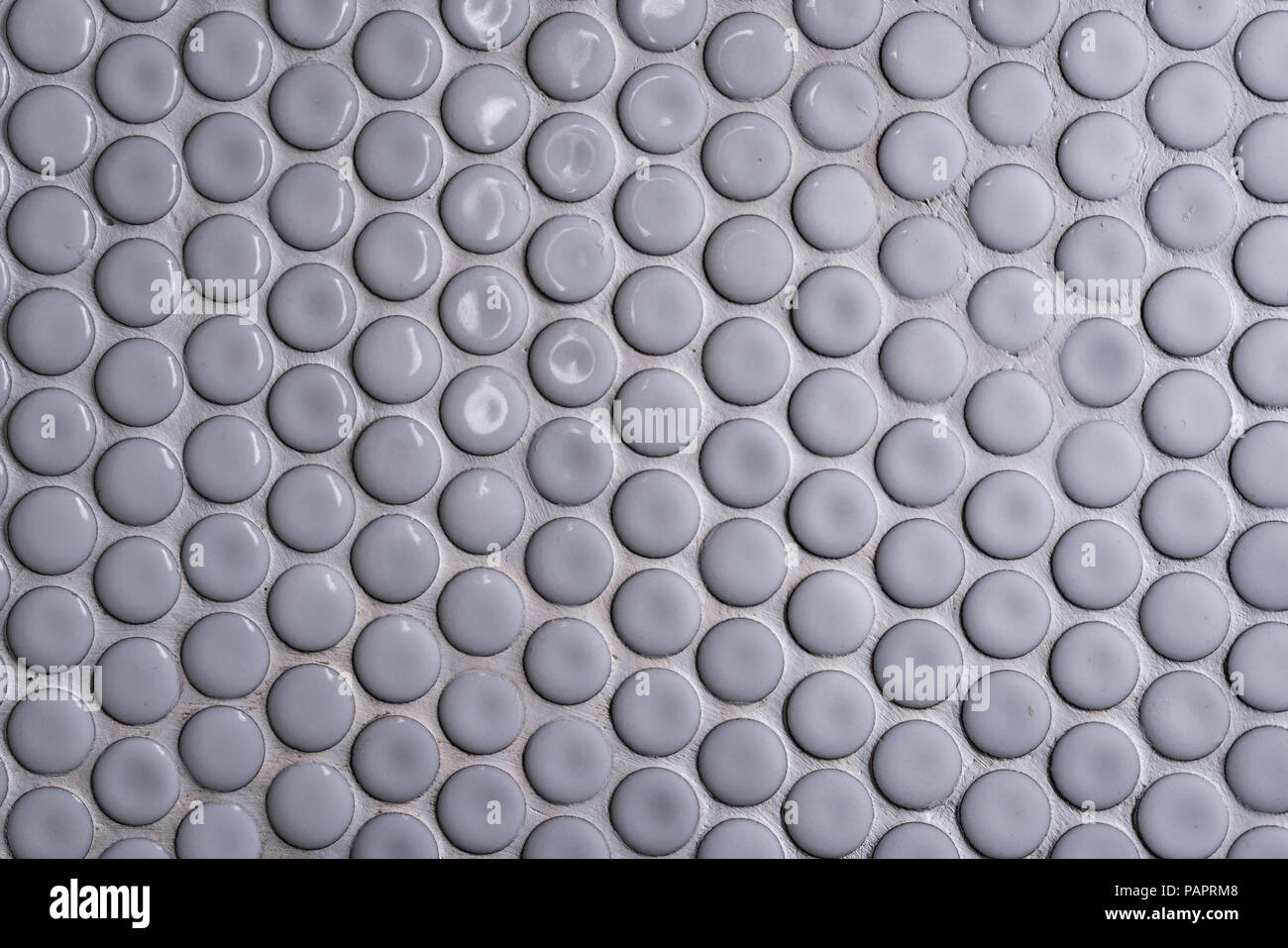 White Ceramic Tile Wall With Many Small Round Unique Pattern Top