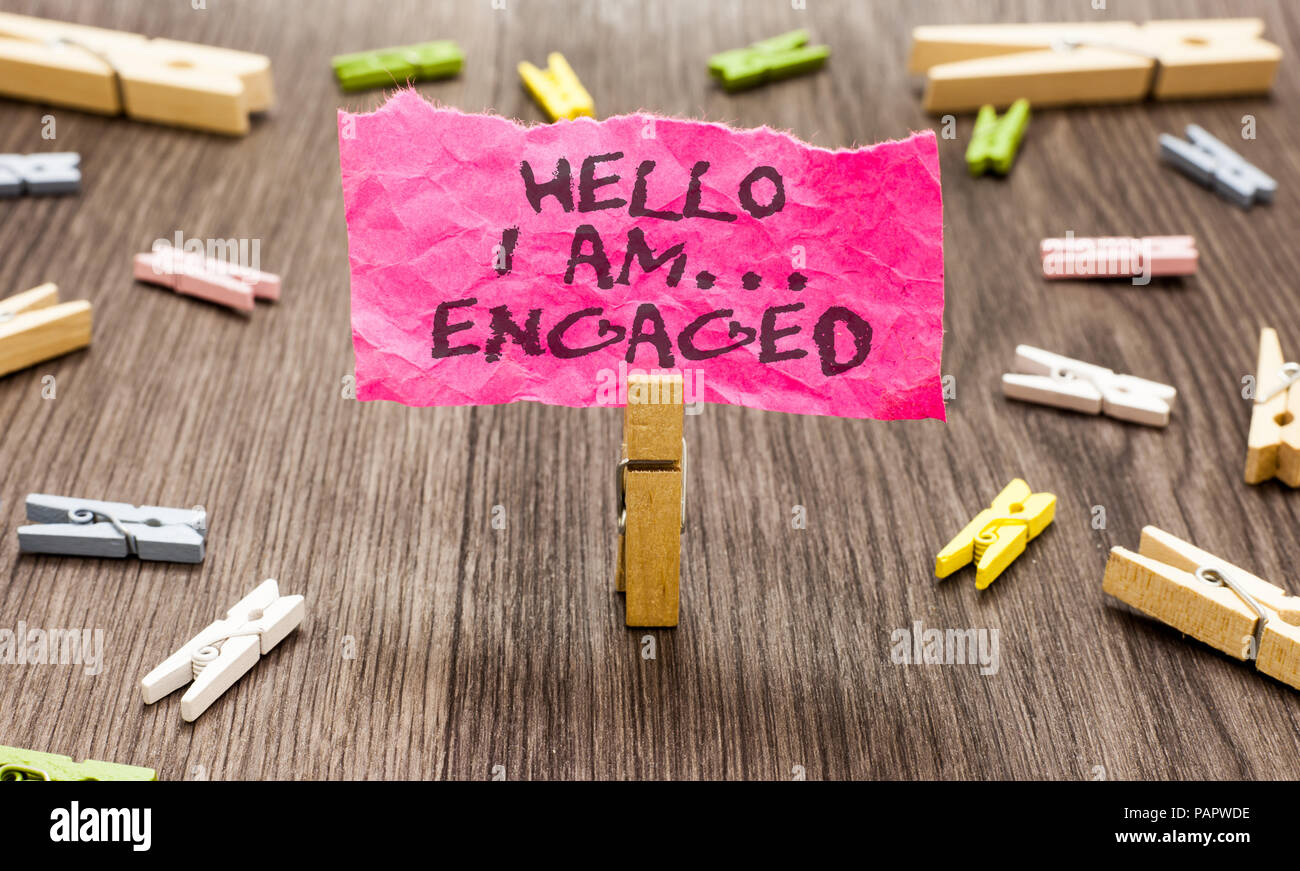 Conceptual hand writing showing Hello I Am... Engaged. Business photo showcasing He gave the ring We are going to get married Wedding Paperclip hold p - Stock Image